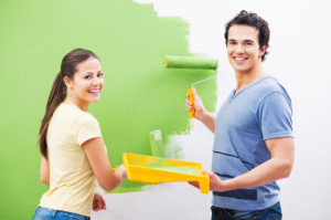 Young couple have fun painting the wall.  [url=http://www.istockphoto.com/search/lightbox/9786786][img]http://dl.dropbox.com/u/40117171/couples.jpg[/img][/url]